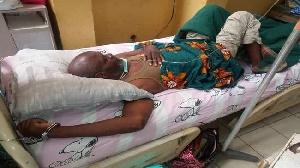 Un prisonnier d'opinion menotté sur un lit d'hôpital