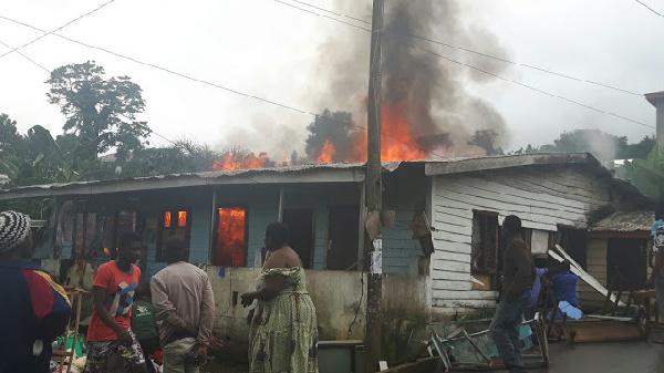 wood bungalow in fire