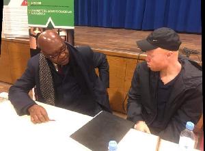 Wilfried Ekanga, analyste politique, ici, posant avec Christian Penda Ekoka