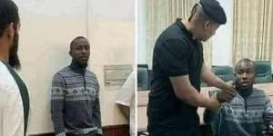 Le Camerounais lors de son arrestation par la police