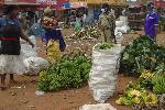 A policeman orders vendors to leave Balikyewunya Market in Luweero town