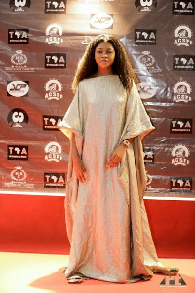 Actress Malvis Mohvu covers up at the 'This Is Africa' movie premiere